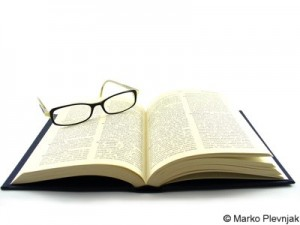 dictionary book with glasses on corner